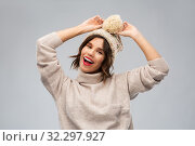 Купить «young woman in knitted winter hat and sweater», фото № 32297927, снято 30 сентября 2019 г. (c) Syda Productions / Фотобанк Лори