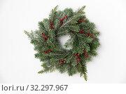 Купить «christmas wreath of fir branches with red berries», фото № 32297967, снято 26 сентября 2018 г. (c) Syda Productions / Фотобанк Лори