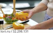Купить «woman cutting pepper in half and removing seeds», видеоролик № 32298131, снято 10 октября 2019 г. (c) Syda Productions / Фотобанк Лори