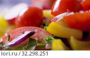 Купить «fresh vegetable salad seasoning with sea salt», видеоролик № 32298251, снято 10 октября 2019 г. (c) Syda Productions / Фотобанк Лори