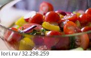 Купить «fresh vegetable salad seasoning with sea salt», видеоролик № 32298259, снято 10 октября 2019 г. (c) Syda Productions / Фотобанк Лори