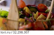 Купить «spoons stirring fresh vegetable salad in bowl», видеоролик № 32298307, снято 10 октября 2019 г. (c) Syda Productions / Фотобанк Лори