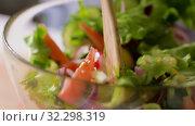 Купить «spoons stirring fresh vegetable salad in bowl», видеоролик № 32298319, снято 10 октября 2019 г. (c) Syda Productions / Фотобанк Лори