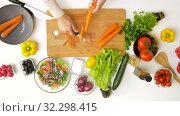 Купить «hands peeling carrot with vegetable peeler», видеоролик № 32298415, снято 10 октября 2019 г. (c) Syda Productions / Фотобанк Лори