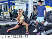 Купить «Couple during weightlifting workout», фото № 32298475, снято 16 июля 2018 г. (c) Яков Филимонов / Фотобанк Лори