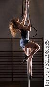 Купить «Young woman in denim shorts practicing pole dancing», фото № 32298535, снято 7 декабря 2019 г. (c) Яков Филимонов / Фотобанк Лори