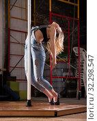 Купить «Beautiful slim girl with pylon. Female pole dancer woman dancing on a pole», фото № 32298547, снято 8 декабря 2019 г. (c) Яков Филимонов / Фотобанк Лори