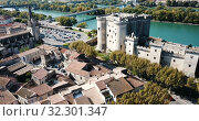 Купить «Aerial view of medieval fortified Chateau de Tarascon and Rhone river at sunny day», видеоролик № 32301347, снято 24 октября 2018 г. (c) Яков Филимонов / Фотобанк Лори