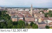 Купить «Scenic cityscape from drone of Italian town of Pordenone in sunny day, Italy», видеоролик № 32301487, снято 2 сентября 2019 г. (c) Яков Филимонов / Фотобанк Лори