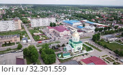 Купить «View from drone of Ozyory cityscape with golden dome of Holy Trinity Church on spring day, Russia», видеоролик № 32301559, снято 13 мая 2019 г. (c) Яков Филимонов / Фотобанк Лори