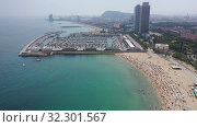 Купить «Scenic view from drone of seaside area of Barcelona on sunny summer day, Catalonia», видеоролик № 32301567, снято 7 июля 2019 г. (c) Яков Филимонов / Фотобанк Лори