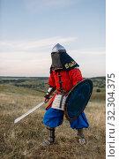 Купить «Medieval knight with sword poses in armor, fighter», фото № 32304375, снято 5 июля 2019 г. (c) Tryapitsyn Sergiy / Фотобанк Лори