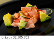 Citrus avocado salmon ceviche. Стоковое фото, фотограф Яков Филимонов / Фотобанк Лори