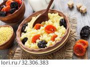 Купить «Millet porridge with dried fruits», фото № 32306383, снято 26 марта 2019 г. (c) Надежда Мишкова / Фотобанк Лори