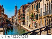 Купить «Venice cityscape with narrow canal», фото № 32307583, снято 5 сентября 2019 г. (c) Яков Филимонов / Фотобанк Лори