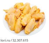 Купить «Uncooked wings of yellow chicken», фото № 32307615, снято 22 октября 2019 г. (c) Яков Филимонов / Фотобанк Лори