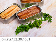 Купить «Natural frigate mackerel fillets and parsley can on wooden table», фото № 32307651, снято 4 августа 2020 г. (c) Яков Филимонов / Фотобанк Лори