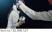 Купить «Fencer puts on mask and becomes fencing combat stance», видеоролик № 32308127, снято 29 сентября 2019 г. (c) Gennadiy Poznyakov / Фотобанк Лори