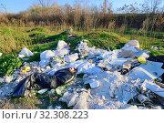 Купить «Corpse of a young girl lies on a landfill», фото № 32308223, снято 3 ноября 2014 г. (c) Арестов Андрей Павлович / Фотобанк Лори