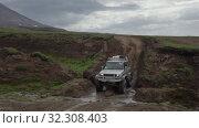 Купить «Extreme off-road car Toyota Land Cruiser Prado driving on muddy mount road», видеоролик № 32308403, снято 16 августа 2019 г. (c) А. А. Пирагис / Фотобанк Лори