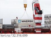 Купить «Crane unloads Russian container ship Sevmorput - nuclear-powered icebreaker lighter aboard ship carrier. Container terminal seaport», фото № 32316699, снято 26 августа 2019 г. (c) А. А. Пирагис / Фотобанк Лори