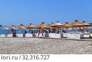 Купить «Budva, Montenegro - June 13.2019. City beach in the resort area with wooden umbrellas», фото № 32316727, снято 13 июня 2019 г. (c) Володина Ольга / Фотобанк Лори