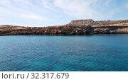 Купить «View from the sea to Cavo Greco in Protaras, Cyprus», видеоролик № 32317679, снято 21 октября 2019 г. (c) Володина Ольга / Фотобанк Лори