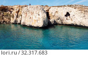 Купить «View from the sea to Caves in Cavo Greco in Protaras, Cyprus», видеоролик № 32317683, снято 21 октября 2019 г. (c) Володина Ольга / Фотобанк Лори