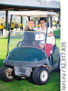 Купить «Male and female golf players driving golf cart at golf course», фото № 32317835, снято 9 июля 2020 г. (c) Яков Филимонов / Фотобанк Лори