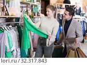 Купить «Couple is choosing jacket for her», фото № 32317843, снято 12 марта 2018 г. (c) Яков Филимонов / Фотобанк Лори