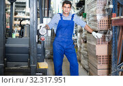 Portrait of vigorous male in uniform on his workplace in building store. Стоковое фото, фотограф Яков Филимонов / Фотобанк Лори
