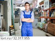 Portrait of adult sellerman in uniform in building store. Стоковое фото, фотограф Яков Филимонов / Фотобанк Лори