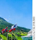 Купить «Luxury cruise liner MSC Meraviglia  In The Fjord Of Olden Norway», фото № 32318583, снято 7 августа 2020 г. (c) Николай Коржов / Фотобанк Лори