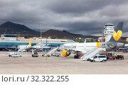 Купить «Aircraft by Thomas Cook is on aerodrome. Thomas Cook Airlines Ltd served leisure destinations worldwide. Sofia Reina, Canary, Tenerife», фото № 32322255, снято 10 января 2016 г. (c) Кекяляйнен Андрей / Фотобанк Лори