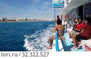 Купить «Protaras, Cyprus - Oct 10. 2019. Tourists sail on sightseeing ship along the shore», видеоролик № 32322527, снято 21 октября 2019 г. (c) Володина Ольга / Фотобанк Лори