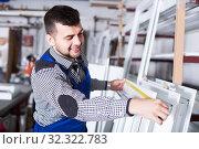 Купить «Workman inspecting PVC manufacturing», фото № 32322783, снято 30 марта 2017 г. (c) Яков Филимонов / Фотобанк Лори