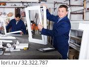 Купить «Workman showing PVC manufacturing output», фото № 32322787, снято 30 марта 2017 г. (c) Яков Филимонов / Фотобанк Лори