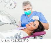 Купить «dentist in uniform health tooth visitor», фото № 32322915, снято 10 октября 2017 г. (c) Яков Филимонов / Фотобанк Лори