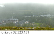 Купить «Rukatunturi (Ruka), ski resort in Kuusamo, and northern hills in fog. Finland», фото № 32323131, снято 6 июля 2015 г. (c) Валерия Попова / Фотобанк Лори