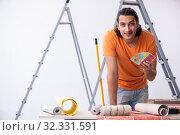 Купить «Young man contractor doing renovation at home», фото № 32331591, снято 4 июня 2019 г. (c) Elnur / Фотобанк Лори