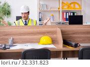 Купить «Young male architect working in the office», фото № 32331823, снято 8 мая 2019 г. (c) Elnur / Фотобанк Лори