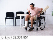 Купить «Young injured man waiting for his turn in hospital hall», фото № 32331851, снято 3 мая 2019 г. (c) Elnur / Фотобанк Лори