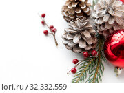 christmas balls and fir branches with pine cones. Стоковое фото, фотограф Syda Productions / Фотобанк Лори