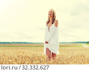 Купить «smiling young woman in white dress on cereal field», фото № 32332627, снято 31 июля 2016 г. (c) Syda Productions / Фотобанк Лори