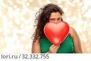 Купить «playful woman holding red heart shaped balloon», фото № 32332755, снято 15 сентября 2019 г. (c) Syda Productions / Фотобанк Лори