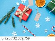 Купить «christmas gifts, branches, tags and decorations», фото № 32332759, снято 26 сентября 2018 г. (c) Syda Productions / Фотобанк Лори