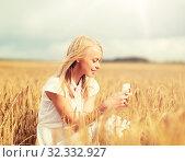 Купить «happy woman with smartphone and earphones», фото № 32332927, снято 31 июля 2016 г. (c) Syda Productions / Фотобанк Лори