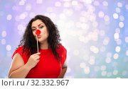 Купить «happy woman with red clown nose posing», фото № 32332967, снято 15 сентября 2019 г. (c) Syda Productions / Фотобанк Лори