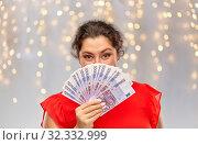 Купить «happy woman holding euro money banknotes», фото № 32332999, снято 15 сентября 2019 г. (c) Syda Productions / Фотобанк Лори