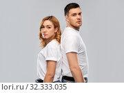 portrait of sad couple in white t-shirts. Стоковое фото, фотограф Syda Productions / Фотобанк Лори